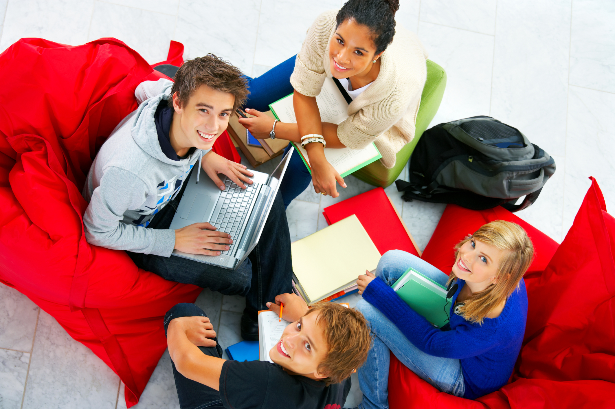 High angle view of students sitting together
